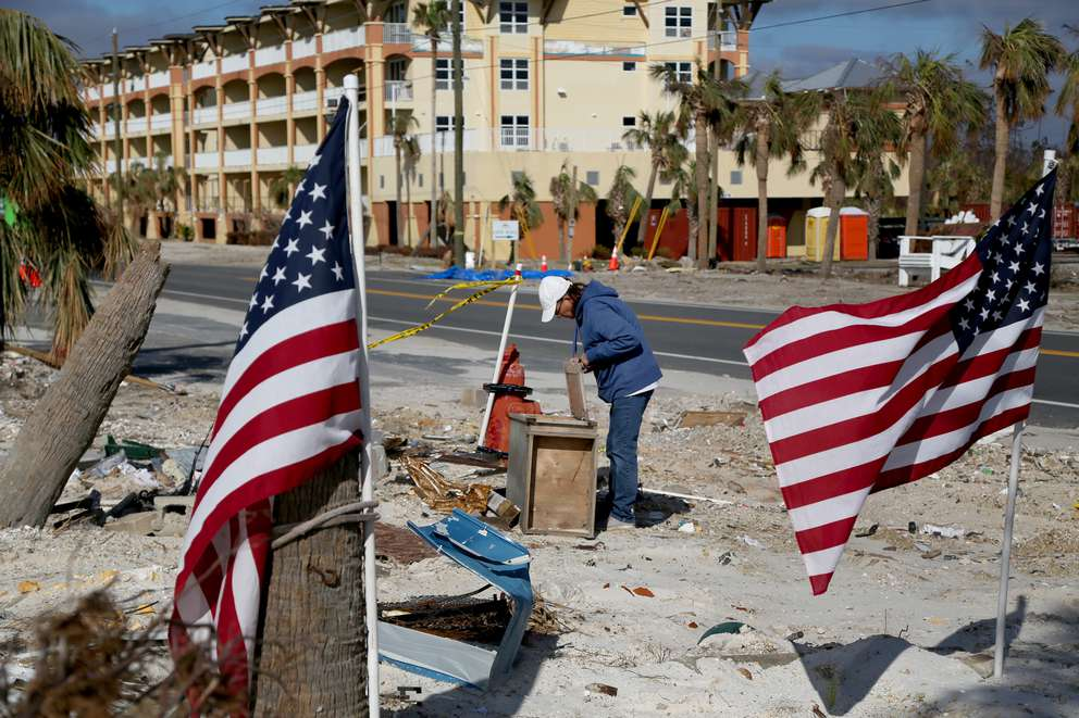 Longtime Driftwood Inn employee Amy Hay searches through rubble left by Hurricane Michael. DOUGLAS R. CLIFFORD | Times