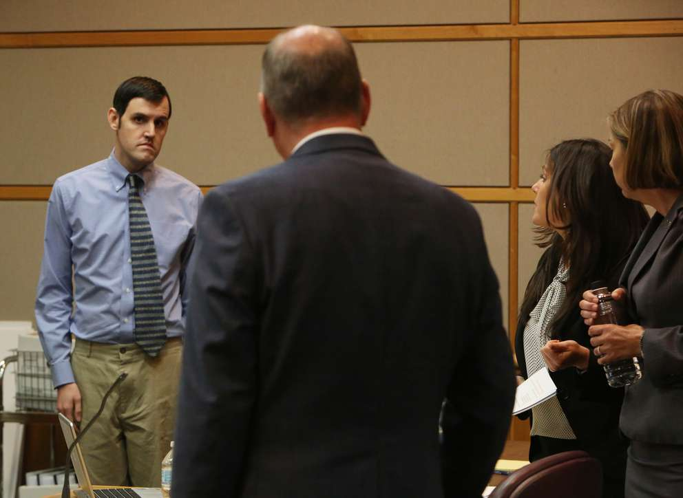 Defendant John Jonchuck, left, talks with his attorneys in court Tuesday. SCOTT KEELER | Times