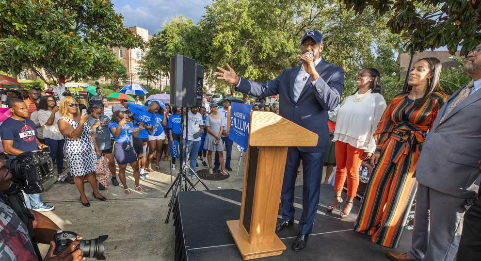 Democratic gubernatorial candidate Andrew Gillum (center) speaks during a campaign rally Monday with his wife R. Jai (third from right) political strategist Angela Rye and author Michael Eric Dyson (right) on the campus of Florida A&M University in Tallahassee. [COLIN HACKLEY | Special to the Times]