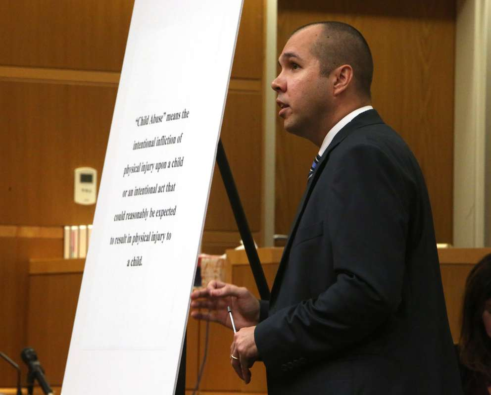 Prosecutor Paul Bolan shows the jury a definition of child abuse in closing arguments Monday. SCOTT KEELER | Times