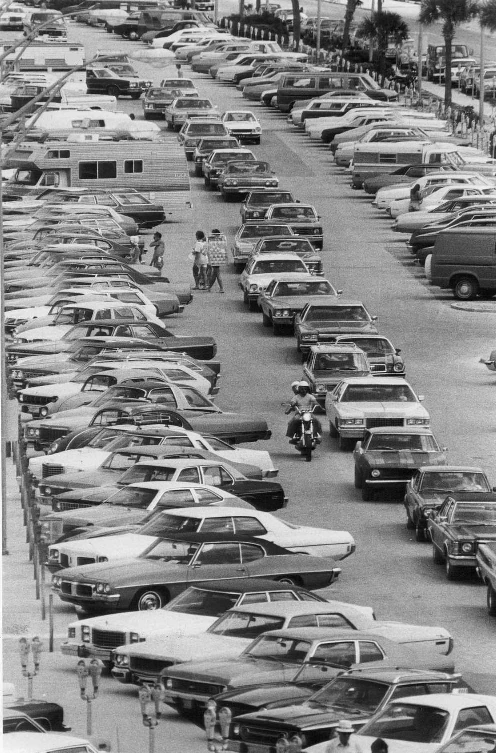 Warm temperatures and sunny skies drew big Easter Morning crowds to Clearwater Beach. The public beach parking lot just south of Pier 60 was reported filled to capacity by 11:30 a.m on the day this photo was taken. Times (1977)