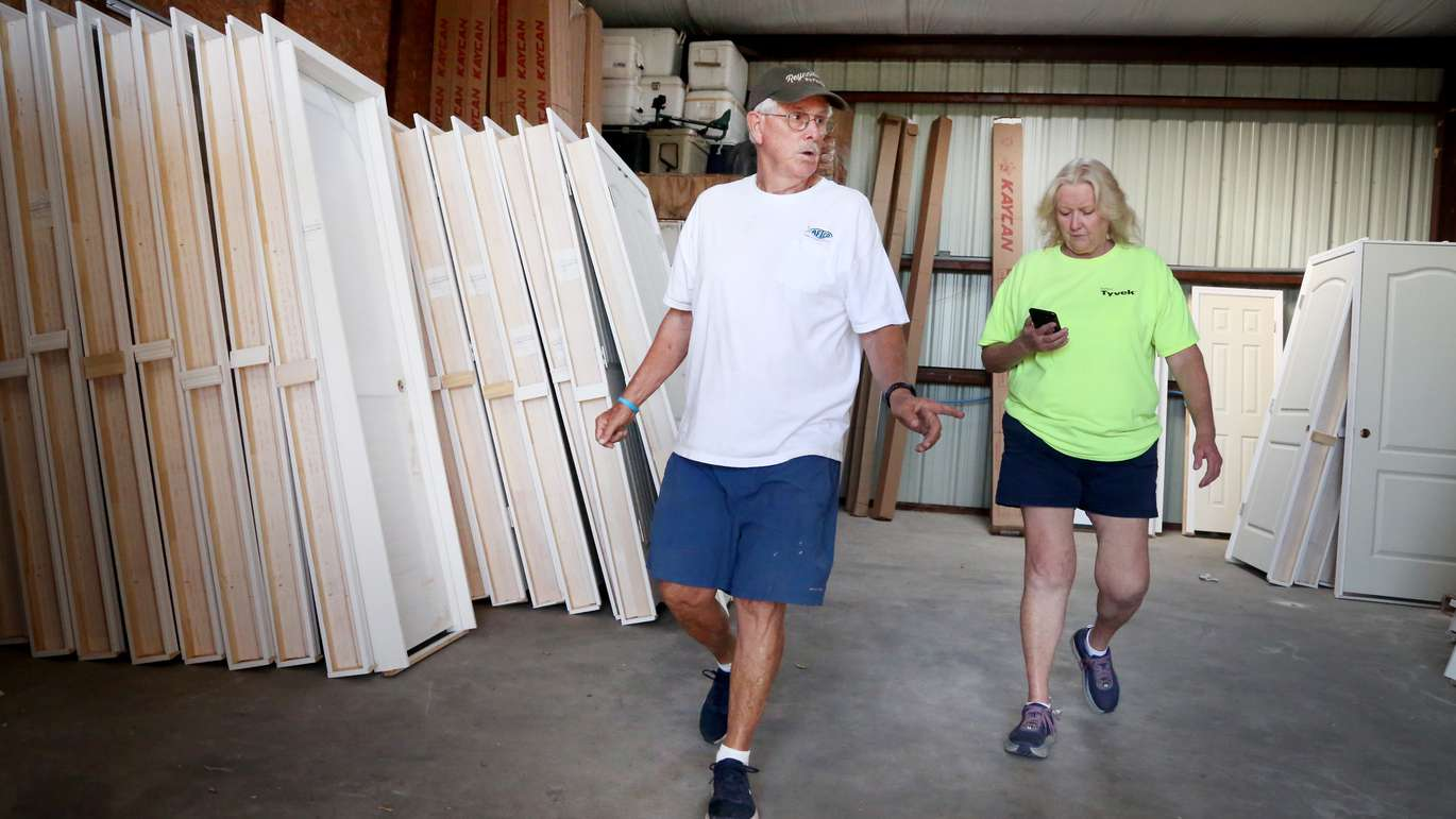 Mexico Beach Mayor Al Cathey, center, takes an inventory of building materials with employee Pam Higgs, right, at his Cathey's Ace Hardware store in downtown Mexico Beach. (DOUGLAS R. CLIFFORD | Times)