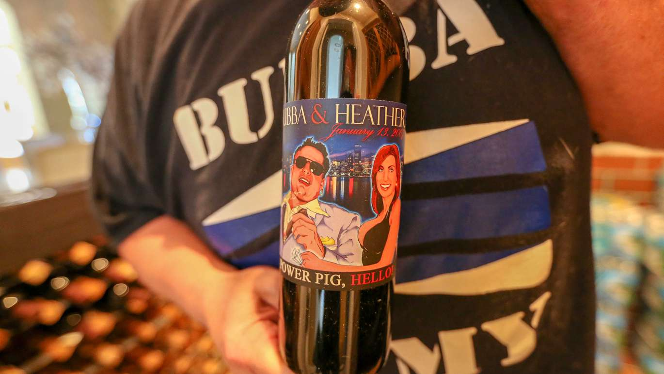 Bubba with a bottle of Bubba and Heather wine from his wedding to his ex-wife. [CHRIS URSO | Times]