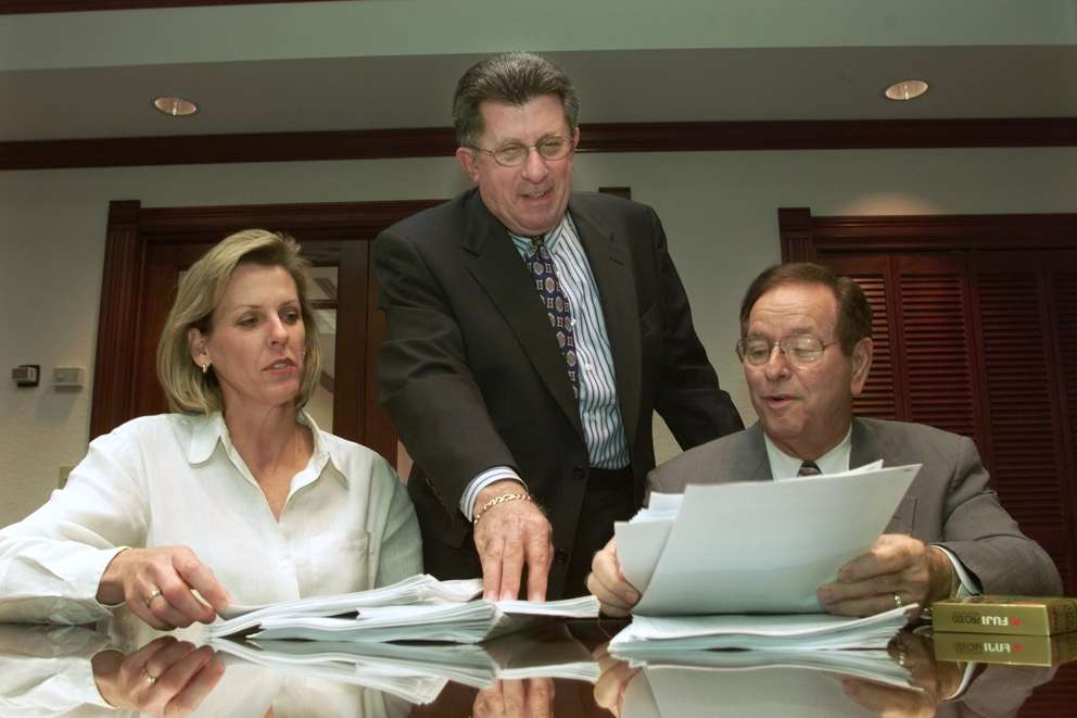 Tampa Police Lt. Jane Castor, City Attorney Jim Palermo and Tampa Mayor Dick Greco look over arrest reports of individuals arrested at adult strip clubs. Times (1999)