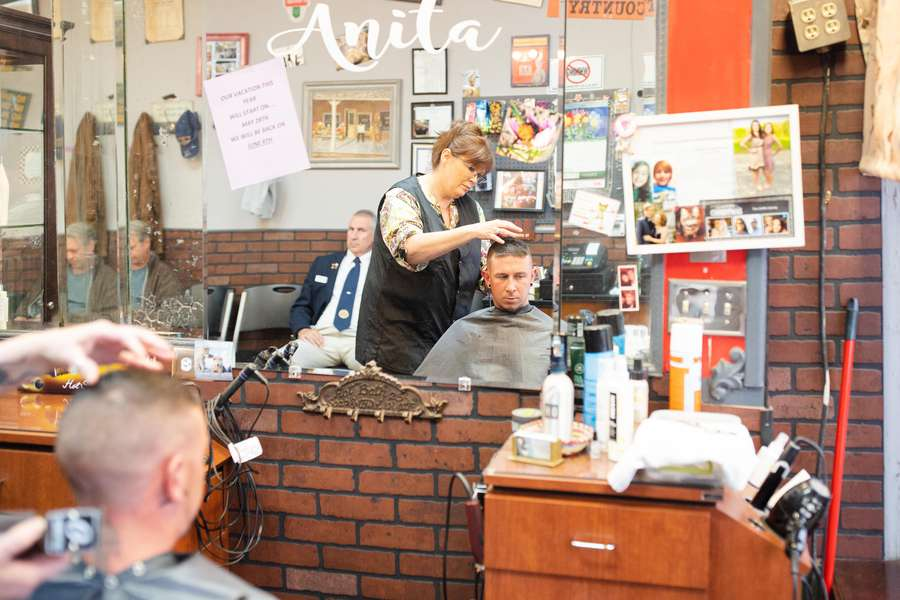 Chris Buckley gets a haircut from Shear Time owner Anita Griffin at her shop in LaFayette, Georgia. [Photo for The Washington Post by Kevin D. Liles.]