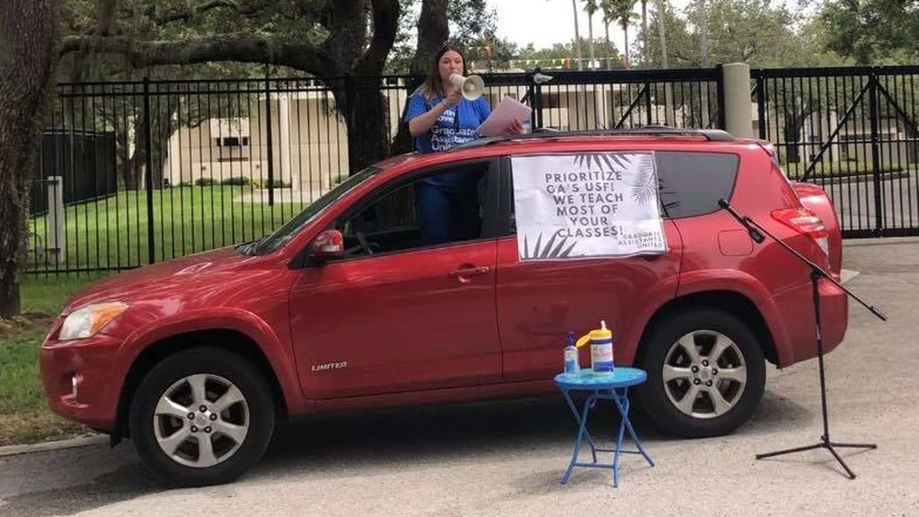 USF graduate students roll out a new kind of protest outside president's  house