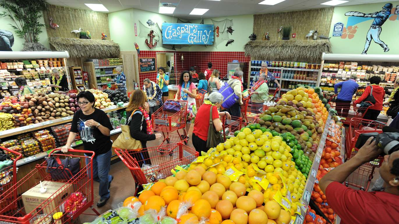 Customers browse the produce section of Trader Joe's. [CLIFF MCBRIDE | Times]