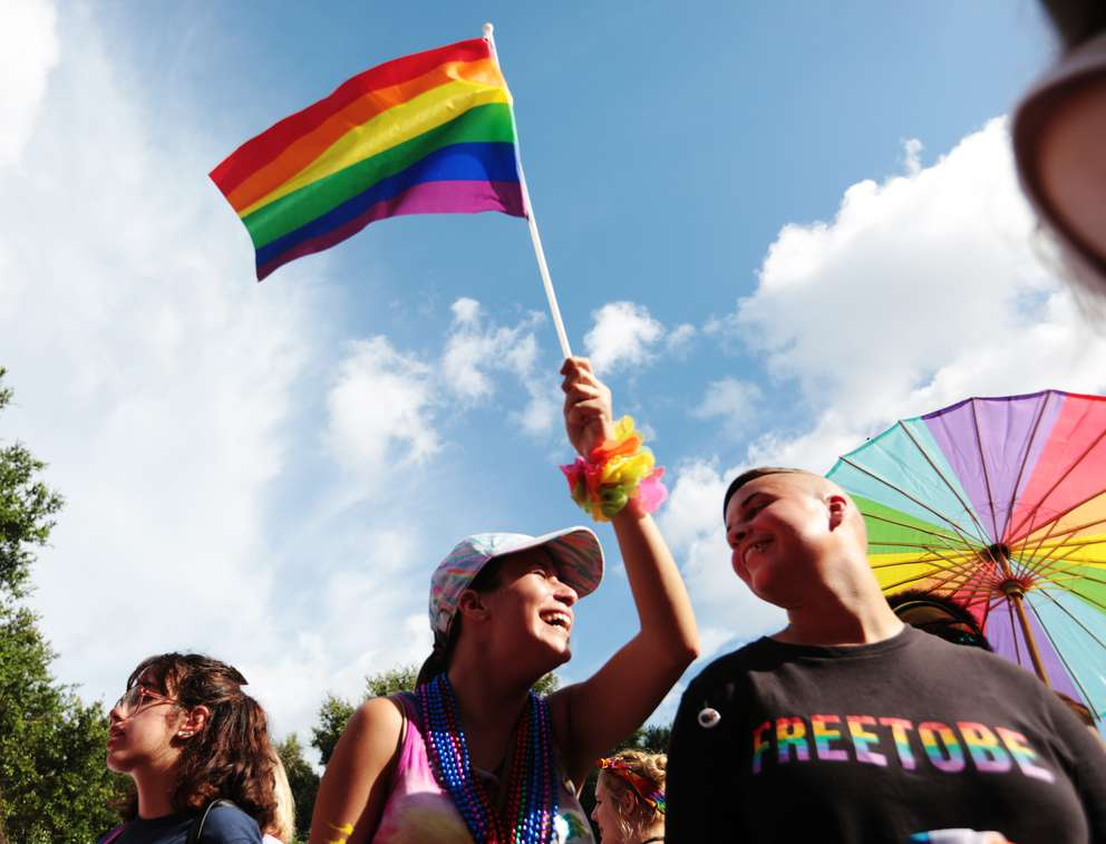 Rachel Schumm, 18, of Trinity, waves a flag with her friend Jessalyn Odum near 5th Avenue before the 2018 St. Pete Pride Parade down Bayshore Drive. Times (2018)