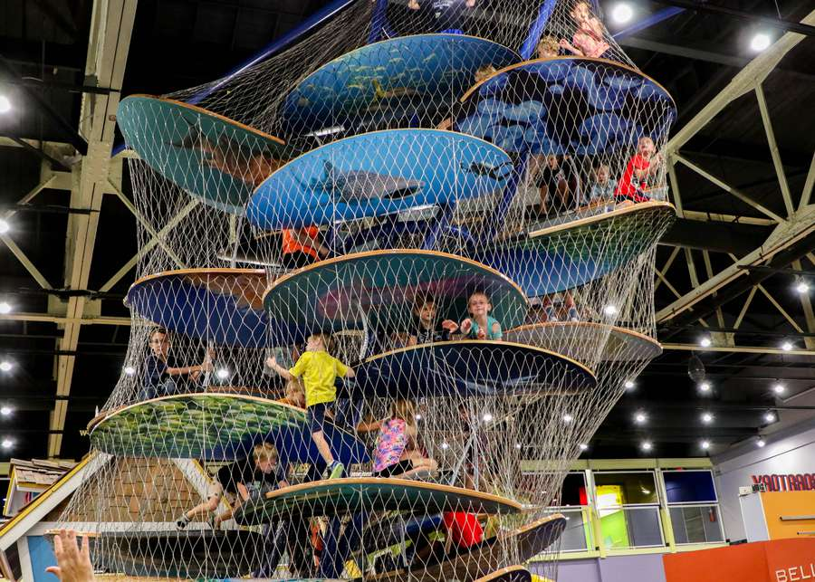 Children climb the Longo's Cove during the exhibit grand opening and ribbon cutting ceremony at Great Explorations Childrens Museum. Evan and Jaime Longoria sponsored the 26-foot-tall climber exhibit. ALESSANDRA DA PRA | Times