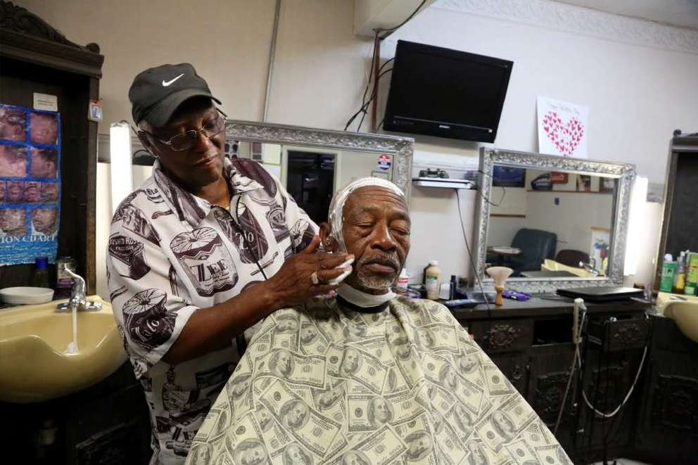 Solomon Davis opened his barbershop in 1989, but he'd been cutting hair for years. One of his former clients was Moses Henry. [DOUGLAS R. CLIFFORD/Times]