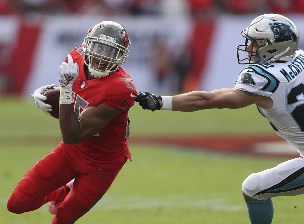 Bucs defensive back Andrew Adams (26) runs after an interception during the first quarter. [MONICA HERNDON | Times]