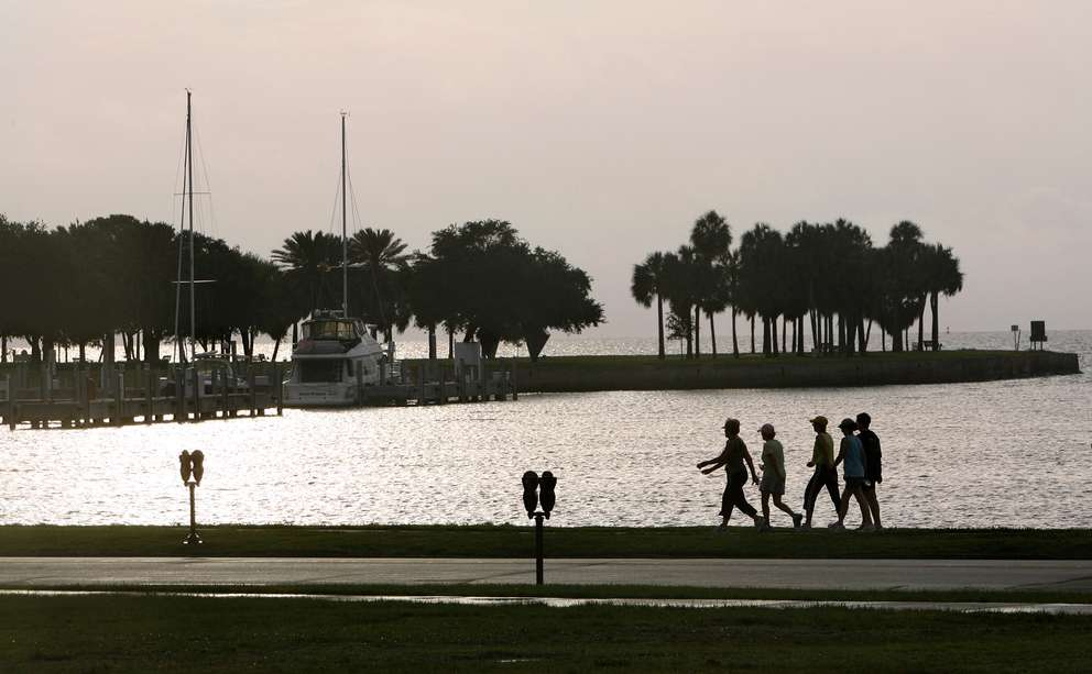 The view of the Vinoy Yacht Basin as morning exercisers make their way along the water from North Straub Park just after sunrise. [DIRK SHADD, Times]
