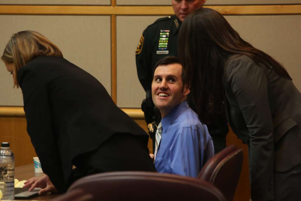 Defendant John Jonchuck smiles to his defense attorney Jessica Manuele at the end of the day in court Thursday. SCOTT KEELER | Times