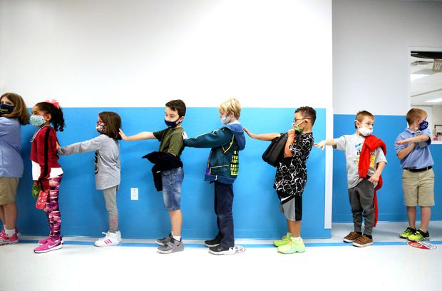 Second-graders practice social distancing while lining up for lunch on Nov. 20 at Innovations Preparatory Academy in Wesley Chapel.