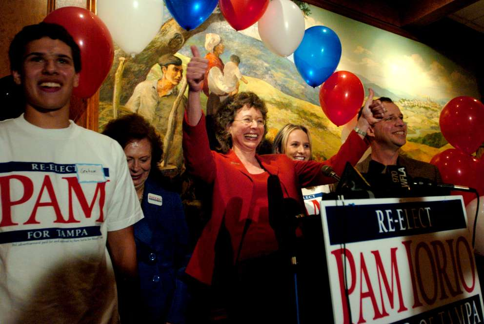 Flanked on stage by her family, Tampa mayor Pam Iorio celebrates her reelection at the Valencia Gardens restaurant on March 6, 2007. [KELVIN MA | Times]