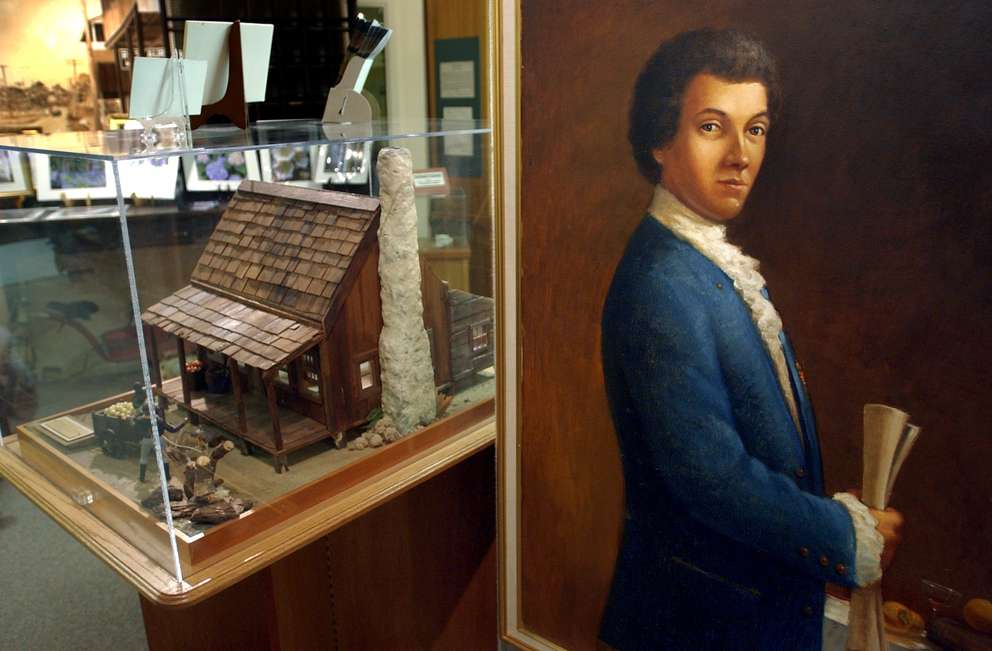 A painting of Odet Philippe hangs on the wall of the Safety Harbor Museum next to a model of his pioneer cabin which was located in what is now Philippe Park, Safety Harbor. [SCOTT KEELER | Times]