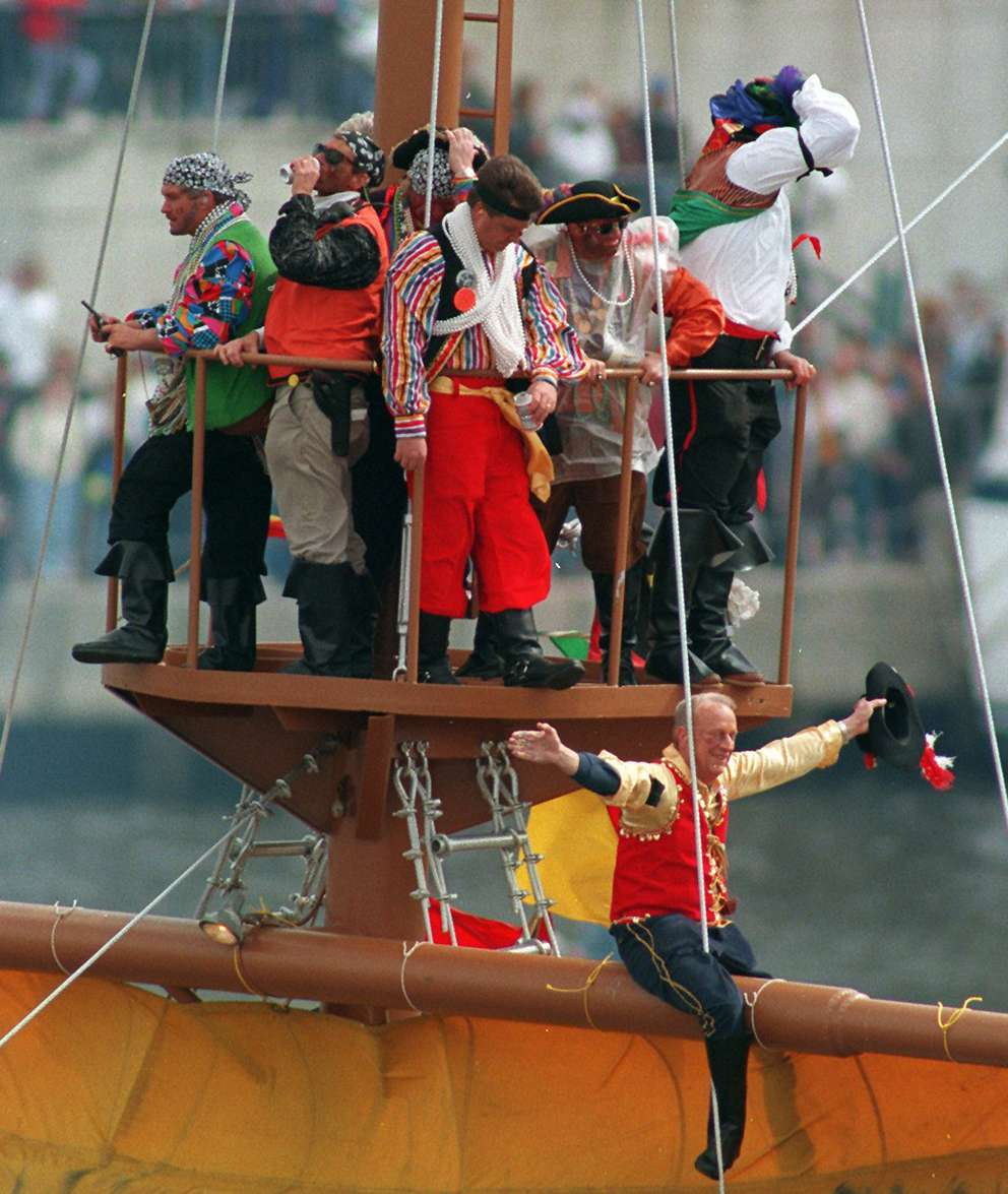 Pirates ride the crows nest of Jose Gasparilla before docking. [Jim Stem | Times archives]