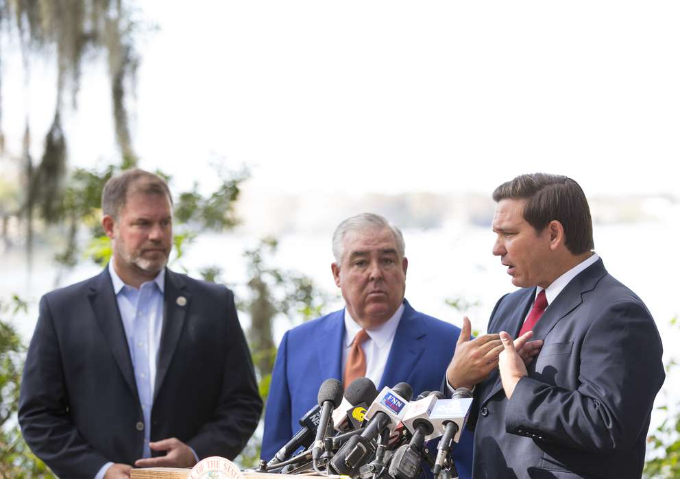 Gov. Ron DeSantis, right, speaks during a press conference with Winter Park Mayor Steve Leary, left, and John Morgan, about his plan to pressure state legislators and give them a mid-March deadline to repeal a law that prohibits smokable forms of medical marijuana at Kraft Azalea Garden in Winter Park on Thursday. (Photo by Willie J. Allen Jr.)
