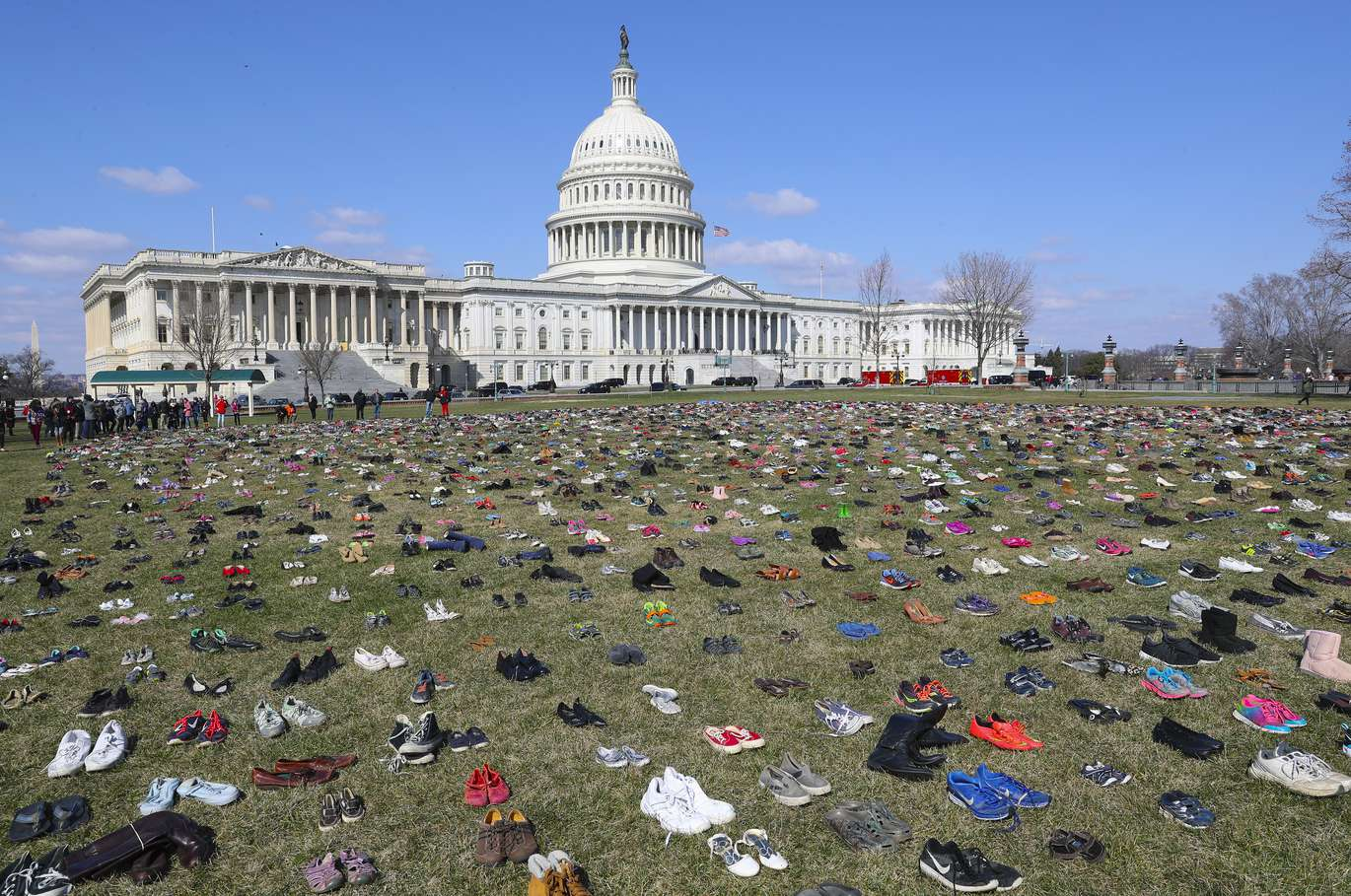 Some 7,000 pairs of shoes, one for every child killed by gun violence since the Sandy Hook school shooting, were placed on the Capitol lawn by Avaaz, ...
