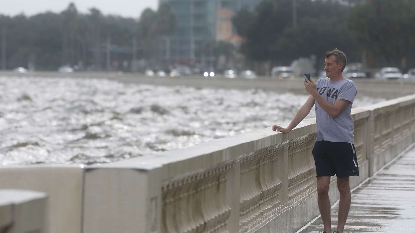 Tampa resident Joe Vandello takes a video of Tampa Bay on Bayshore Blvd. during high tide Wednesday, Oct. 10, 2018. While the panhandle is taking the brunt of Hurricane Michael, Bayshore Blvd. in Tampa is experiencing some flooding from a choppy Tampa Bay which is more than 300 miles from where the storm's eye made landfall. (James Borchuck, Times)
