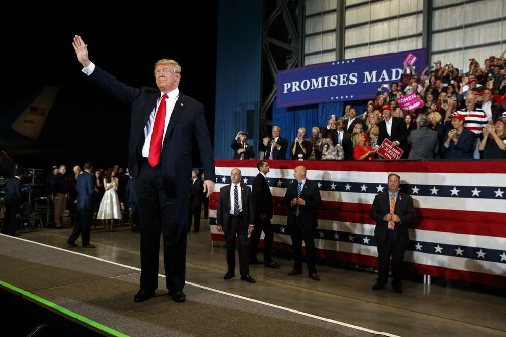President Donald Trump arrives for a campaign rally at Pensacola International Airport, Saturday in Pensacola. (AP Photo/Evan Vucci)