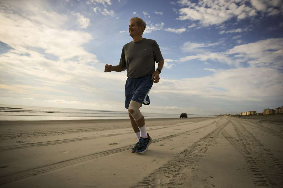 Senator Bill Nelson runs along American Beach on Amelia Island south of Fernandina Beach on Sept. 2. (WILL VRAGOVIC | Times)