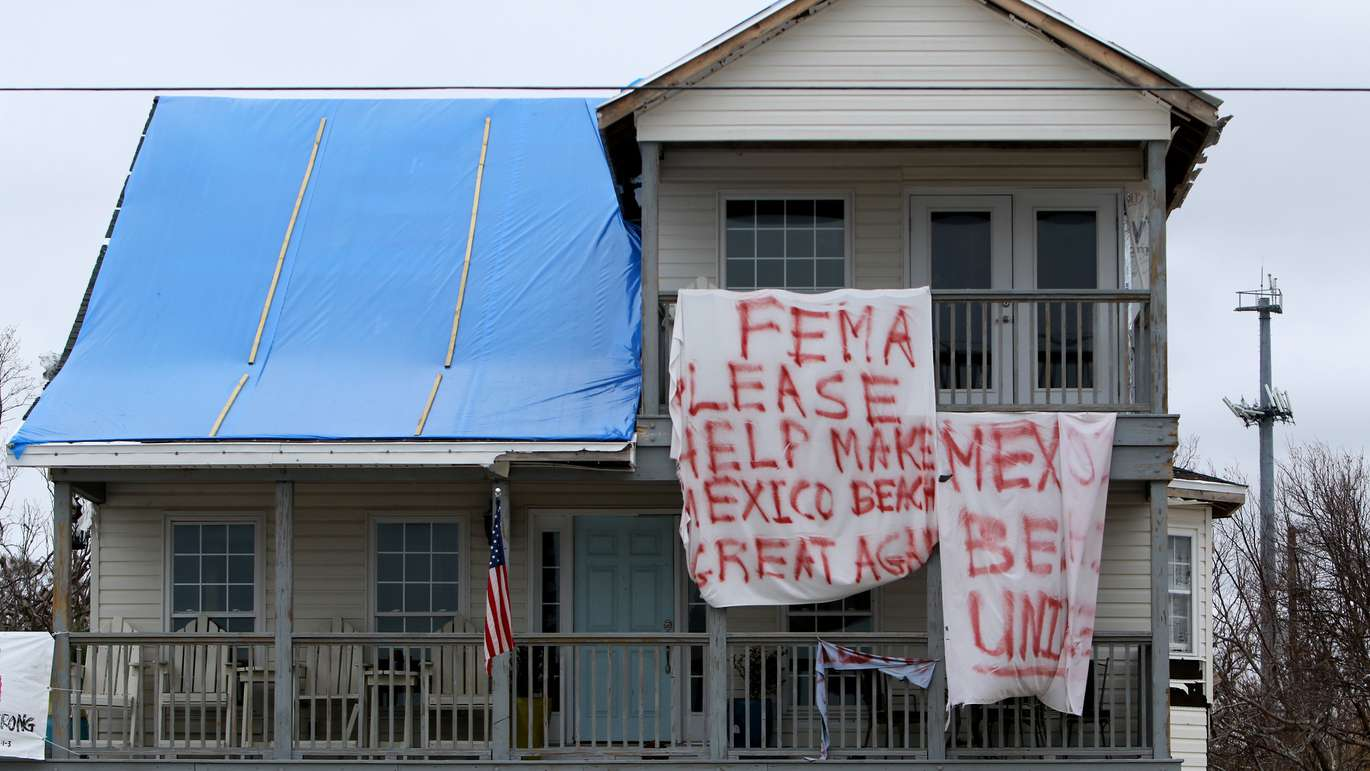 A sign beckons the attention of FEMA on a Mexico Beach home, which remains in a mostly suspended state of destruction since Hurricane Michael made landfall two months ago. (DOUGLAS R. CLIFFORD | Times)