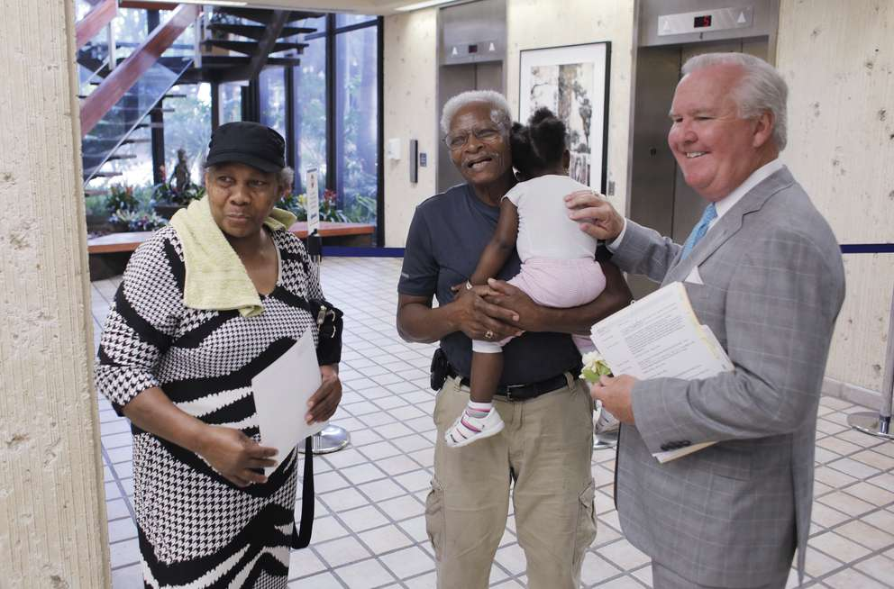Mayor Bob Buckhorn, right, talks with retired City of Tampa employee Willie Grubbs, center, and his 1-year-old granddaughter Alaya Allen and wife, Susie Grubbs, left, in the municipal building in downtown Tampa on April 11. (OCTAVIO JONES | Times)