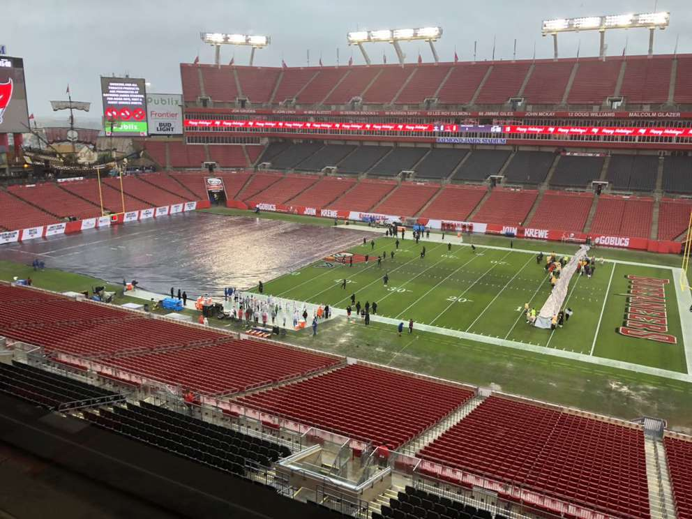 Players test their footing before Sunday's Bucs-Saints game at Raymond James Stadium. [EDUARDO A. ENCINA | Times]