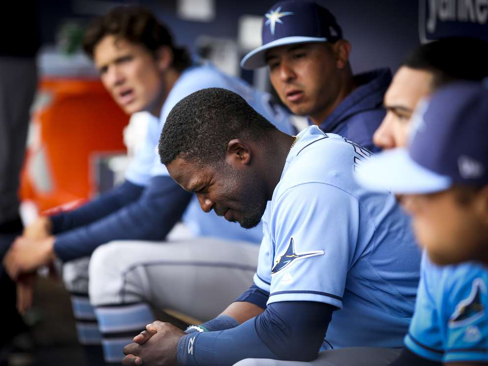 Tampa Bay Rays left fielder Guillermo Heredia (54) smiles as he sits in the dugout during the Tampa Bay Rays spring training game against the New York Yankees on March 19, 2019 at Steinbrenner Field in Tampa, Fla. [TAILYR IRVINE | Times]