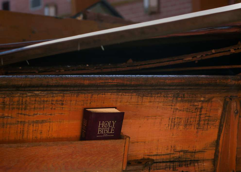A bible sits among the wreckage of Chapel 2 at the Tyndall Air Force Base. Crews are still working to clear debris and repair damaged buildings nearly three months after Hurricane Michael devastated the area. [TAILYR IRVINE | Times]