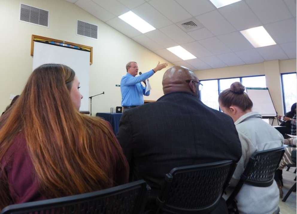 Lance Rettig, the executive director of Bay County's affiliate of Habitat for Humanity, speaks to the Bay County Long Term Disaster Recovery Organization gathered on Jan. 24, 2019. EMILY L. MAHONEY | TIMES