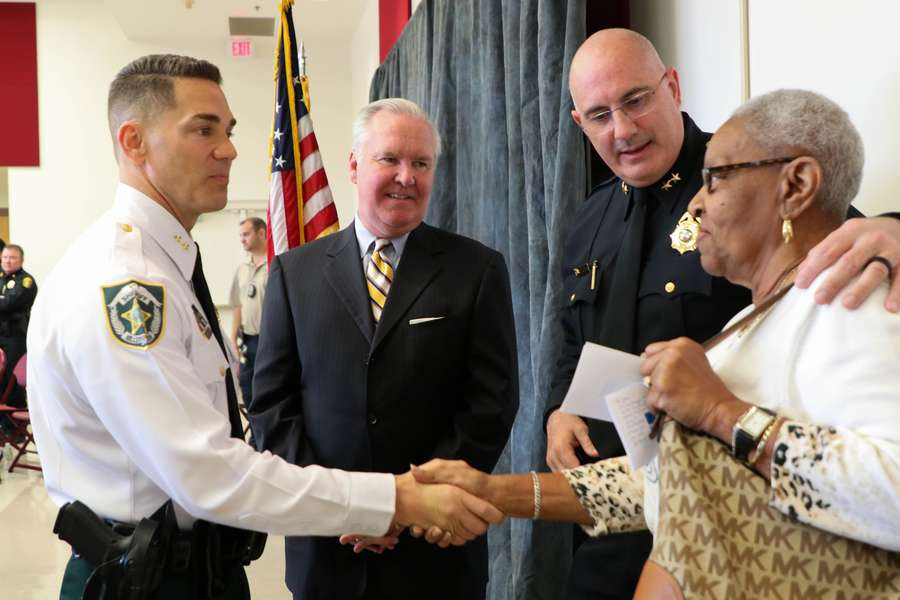 Mayor Bob Bob Buckhorn, center, has known Sheriff Chad Chronister, left, about eight years and sees his ascension as part of a process that works. The two men attended a neighborhood meeting in January after an arrest in the Seminole Heights slayings, a gathering also attended by Aretha Jones of Tampa, right, mother of a victim in the slayings, and Tampa Police Chief Brian Dugan. [ALESSANDRA DA PRA | Times]