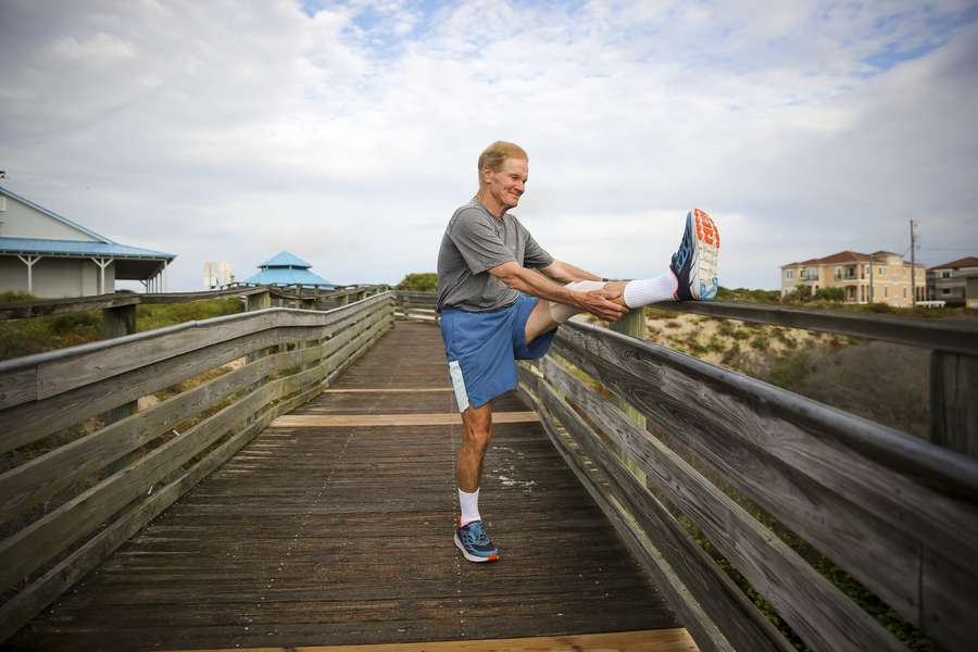 Sen. Bill Nelson stretches on the boardwalk before starting his run along American Beach on Amelia Island south of Fernandina Beach on Sept. 2. (WILL VRAGOVIC | Times)