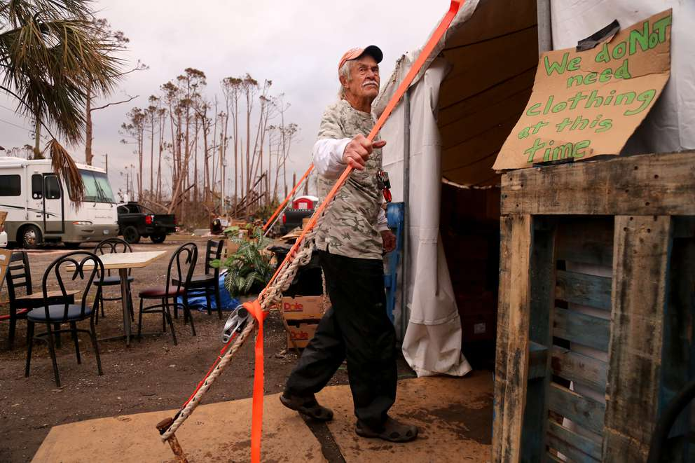 Chuck McKibbon arrives at a supplies tent in Mexico Beach in early December. DOUGLAS R. CLIFFORD | Times