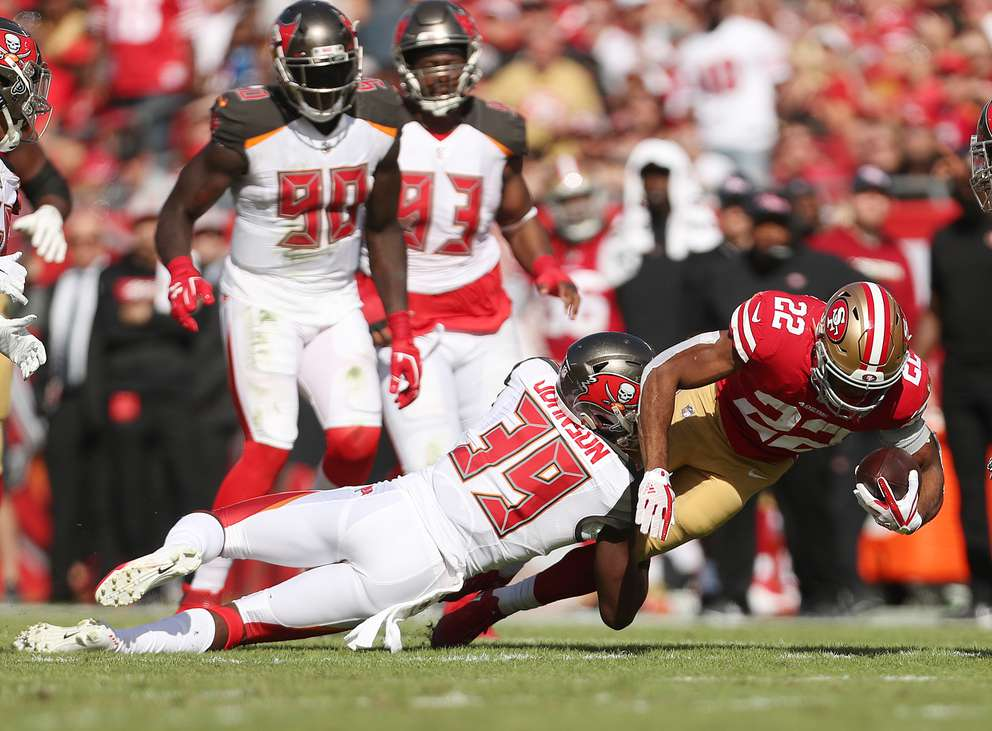 San Francisco 49ers running back Matt Breida (22) is tackled by Bucs free safety Isaiah Johnson (39) during the second quarter. [MONICA HERNDON | Times]