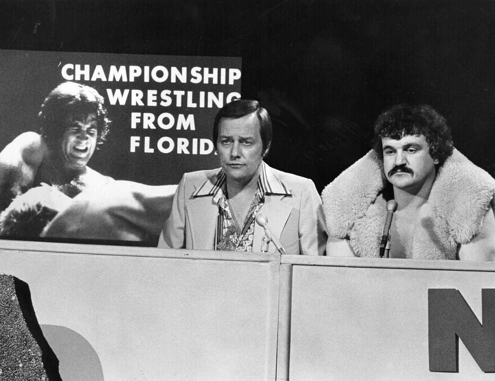 Gordon Solie with wrestler Buddy Wolff on Championship Wrestling From Florida. [Times files (1977)]