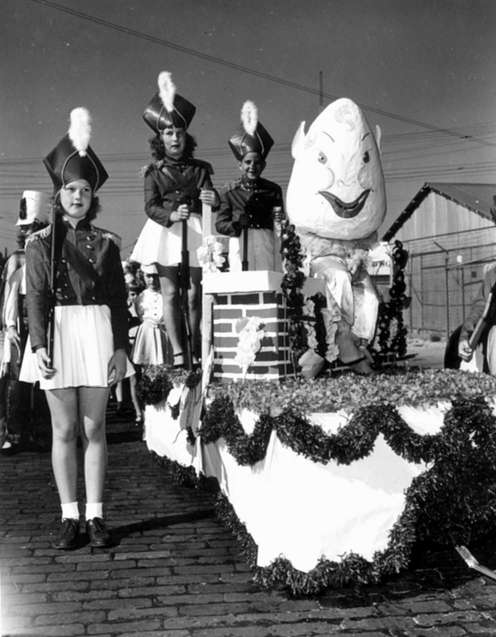Three children participate in the 1949 Gasparilla children's parade. [Photo courtesy of the State Library and Archives of Florida]