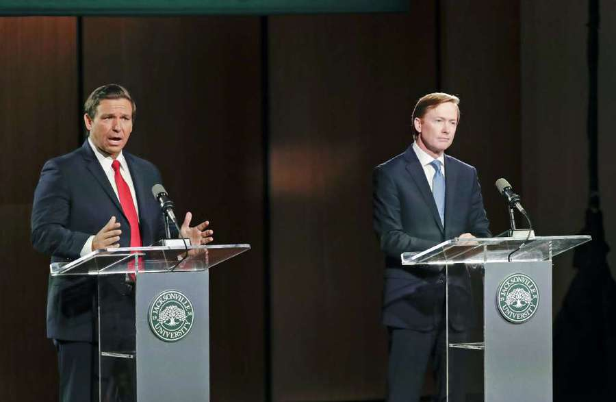 Republican gubernatorial candidate Ron DeSantis (left) debates Adam Putnam in Wednesday's second and final debate at Jacksonville University. [AP | John Raoux]