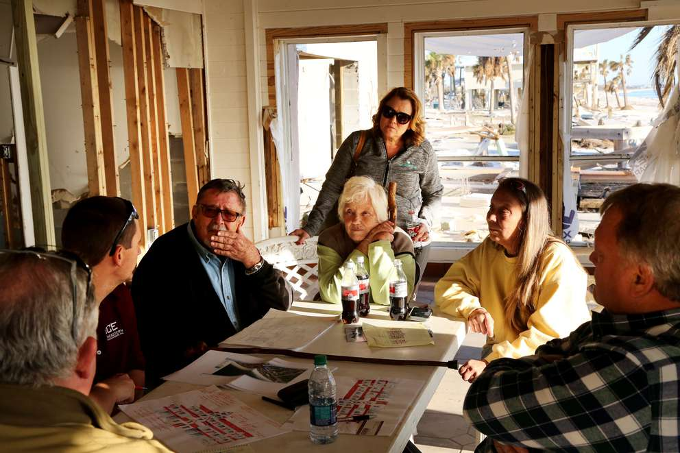 From left, clockwise, builder Finley Cook, engineer Lance Watson, Tom Wood, Peggy Wood, Brandy Wood Jessen, Shawna Wood and architect Bill Bridges meet at the site of the Driftwood Inn to discuss plans to reconstruct the beachfront motel, which was destroyed by Hurricane Michael. DOUGLAS R. CLIFFORD | Times
