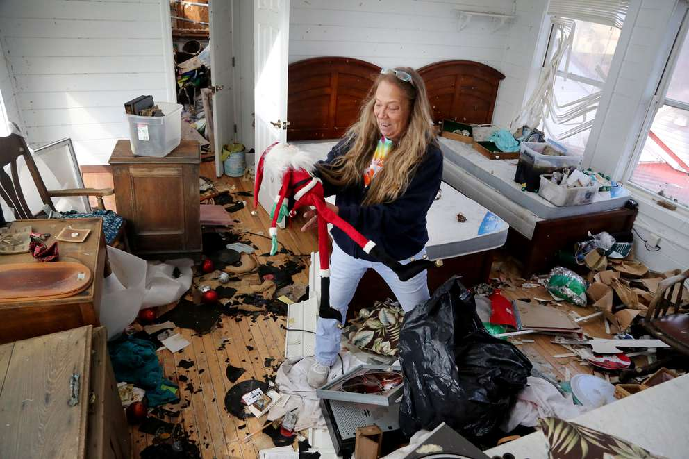 Shawna Wood, 54, finds a Santa decoration in the top floor loft of the Driftwood Inn. DOUGLAS R. CLIFFORD | Times