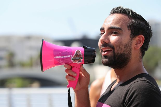 Timothy Rivera, 27, of Austin, Texas, leads a #FreeBritney rally at Curtis Hixon Waterfront Park on Saturday, July 10, 2021 in Tampa.