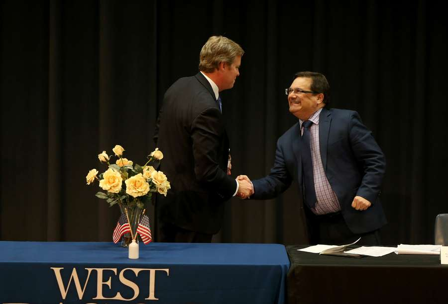 Democrat Chris Hunter (left) shakes hands with U.S. Rep. Gus Bilirakis, R-Palm Harbor, at the end of Monday night's debate candidate forum at the candidate forum at Pasco-Hernando State College in New Port Richey. Bilirakis has held Florida's 12th Congressional District for 12 years.[DOUGLAS R. CLIFFORD   Times]