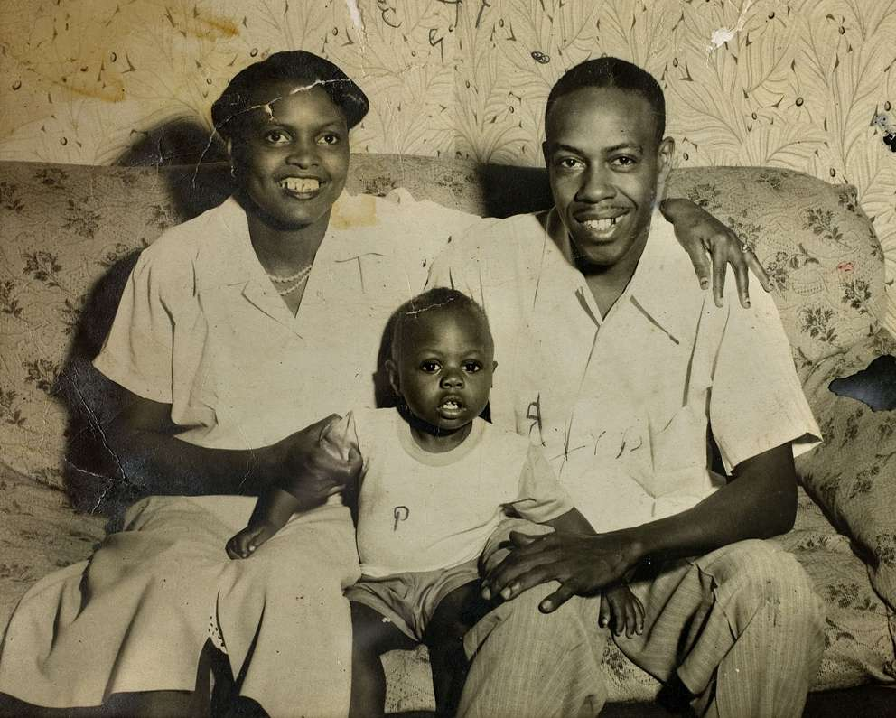 Willie Robinson Jr., shown here around age 2 in his family's living room with parents Willie Robinson Sr. and Sarah Jackson Robinson.