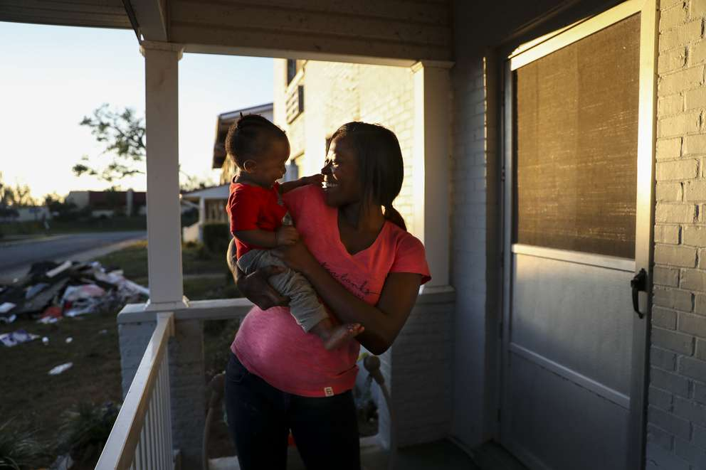 Latoya Jackson and her son Benny rode out Hurricane Michael in their apartment at the Massalina Memorial Homes public housing complex. Jackson and her two children took shelter in a closet. [MONICA HERNDON | Times]