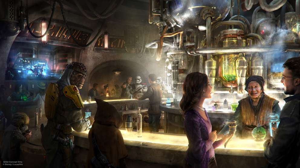 Oga's Cantina at Star Wars: Galaxy's Edge is a local watering hole to unwind, conduct business and maybe even encounter a friend or a foe. Patrons of the cantina come from across the galaxy to sample the famous concoctions created with exotic ingredients served in unique vessels, with choices for kids and libations for adults. Courtesy of Disney Parks.