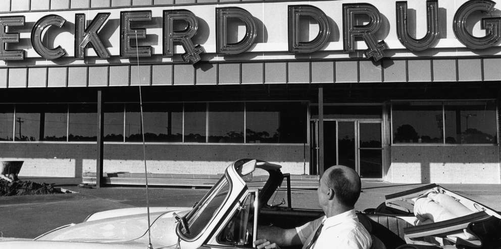 Jack Eckerd in front of an Eckerd Drugs. [RON WAHL | Times]