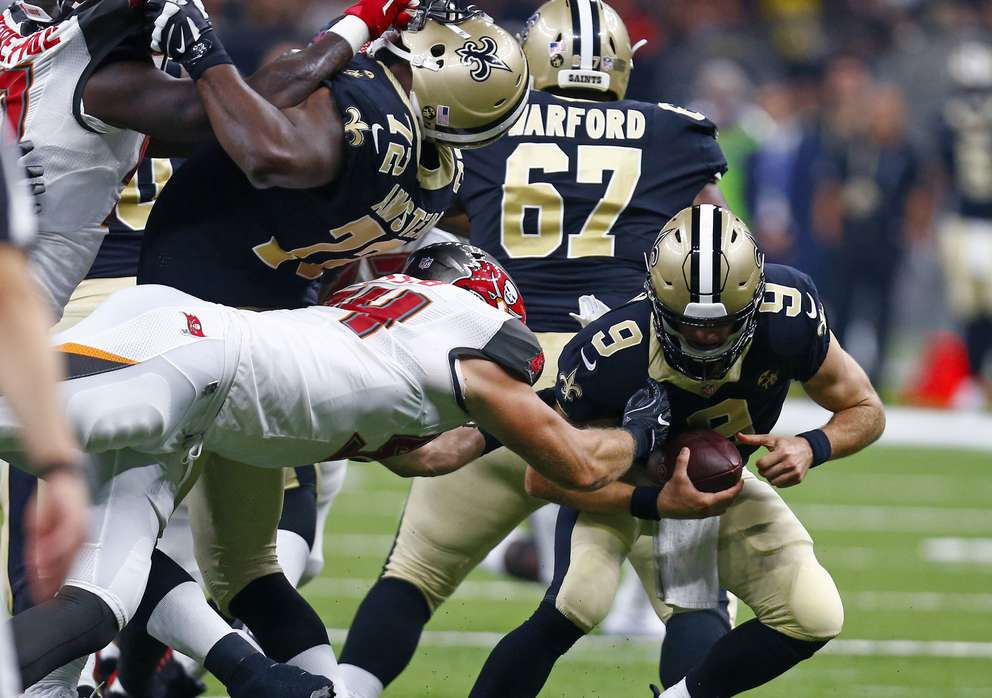 33f771f99f9c1 New Orleans Saints quarterback Drew Brees (9) eludes a sack by Tampa Bay  Buccaneers