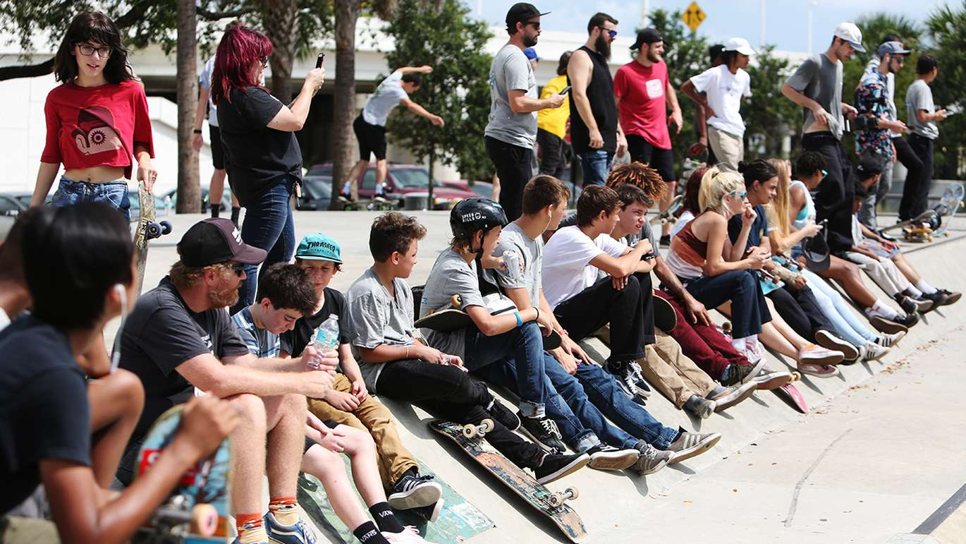 Observers watch skaters attempt to land difficult tricks during the Go Skateboarding Day at the Bro Bowl located at Perry Harvey Sr. Park Thursday, June 21, 2018 in Tampa.
