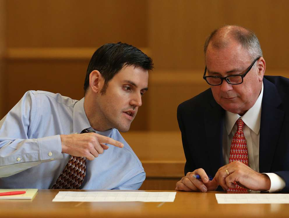 SCOTT KEELER | Times John Jonchuck, left, talks with defense attorney Greg Williams while appearing before Judge Chris Helinger during the first day of jury selection on Monday (3/18/19) at the Pinellas County Criminal Justice Center in Clearwater.